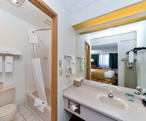 Full bathroom and sink vanity at Quality Inn Klamath Falls